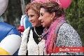 Gloria Estrada y Martha Elena de Meade disfrutando de la belleza de las flores.