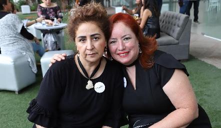 María del Rosario Flores y Elizabeth Santaella.