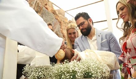 Diego siendo bautizado.